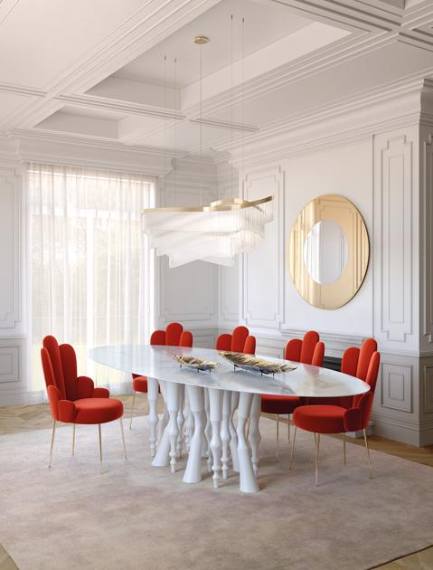 Descrição da imagem: Cadeiras vermelhas e mesa de jantar pernas tipo patas de cavalo e tampo em mármore