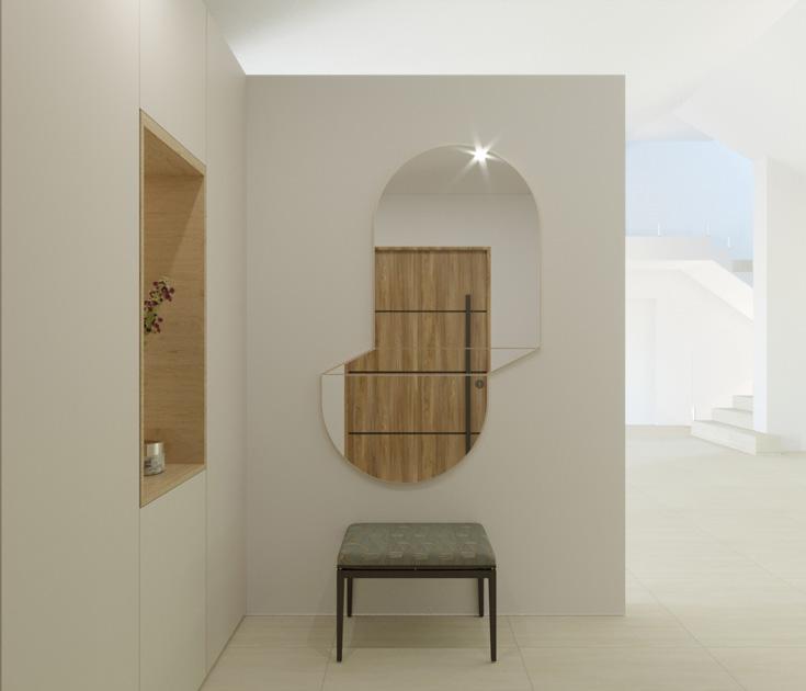 Descrição da imagem: Espelho decorativo geométrico vertical num hall de entrada por cima de banco.