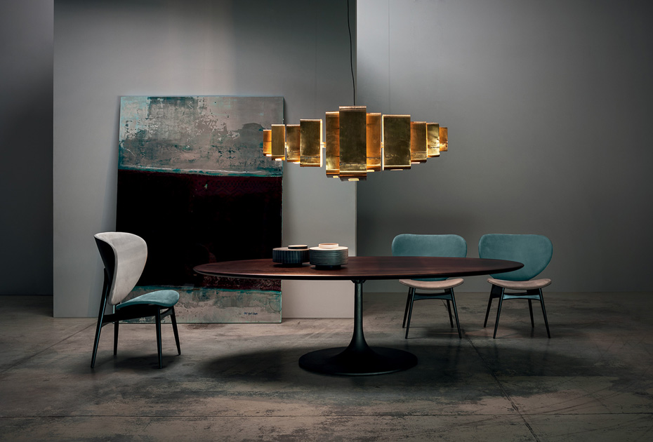 Image Description: leather chair for dining room by Baxter, model Alma with dining table, pendant lamp and art.