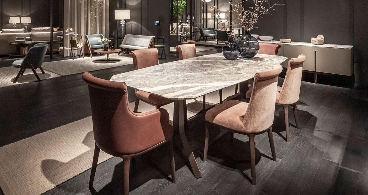 Descrição da Imagem: Cadeira para sala de jantar da marca Poltrona Frau, modelo Diva, com mesa de jantar.