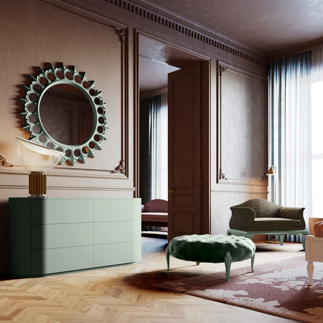 Image Description: bedroom with chest of drawers, mirror, pouf and armchair all in soft green.