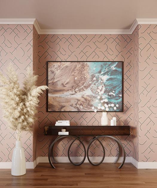 Descrição da imagem: hall com consola de vidro e ferro e papel de parede de celulose com padrão geométrico